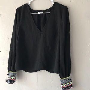 Tobi small black blouse with fun sleeves!